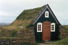 Sod house-neat greenhouse idea, small house by the beach.