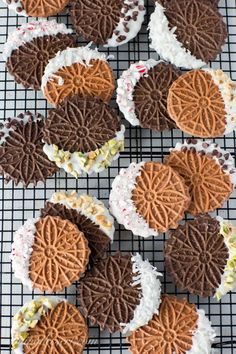 Chocolate Pizzelles - Saving Room for Dessert Chocolate Pizzelles dipped in white chocolate with peppermint, walnuts, chocolate chips, coconut and pistachios Easy Christmas Cookie Recipes, Holiday Treats, Christmas Baking, Christmas Treats, Christmas Cookies, Holiday Recipes, Christmas Chocolate, Gingerbread Cookies, Pizzelle Cookies