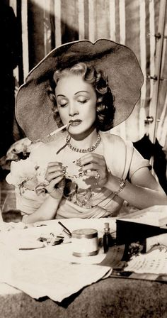MARLENE DIETRICH smoking in Alfred Hitchcock's very underrated STAGE FRIGHT 1950. Rare vintage b/w photo detail. Marlene is still selling glamour at 48 as only she can & steals the film. (please follow minkshmink on pinterest)