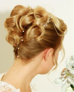 A long blonde straight coloured sculptured wedding bridal updo hairstyle by Patrick Cameron