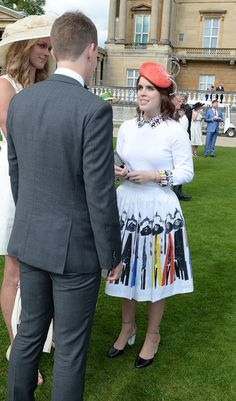 Princess Eugenie (right) talks to guests during guests attending a garden party at Buckingham Palace on May 24, 2016 in London, England. - Elevated View Of The Queen's Garden Party
