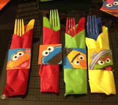 Plastic cutlery presented with just-for-fun Elmo details.  See more Elmo birthday party ideas at www.one-stop-party-ideas.com