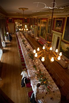 Goodwood House Ballroom with long table - flowers by Spriggs Florist