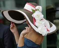 A spectator shows off her Derby hat before the 137th Kentucky Derby horse race at Churchill Downs Saturday, May 7, 2011, in Louisville, Ky. (AP Photo/Ed Reinke)