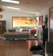 Mid-Century Modern living room, orange awning, Modernica Case Study V-leg daybed, Vintage Burke shell chairs