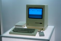 The original Macintosh with screen, keyboard, mouse and note the external floppy drive.