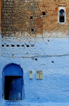 Morroco. I like seeing the natural brick color and the paint. I wonder why they stopped. Hmm.