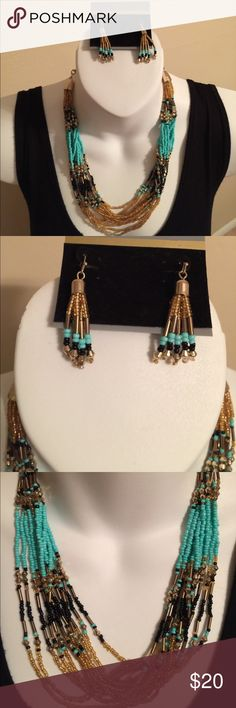 """Beautiful Turquoise, Black and Gold Necklace set Beautiful Turquoise, Black and Gold Necklace set. Fish hook earrings. Dress up or dress down. Such a beautiful piece. 14"""" plus extender chain makes Overall length 24"""" Jewelry Necklaces"""