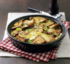 This cheesy vegetarian recipe is comfort food heaven and a savoury take on the classic British bread and butter pudding.
