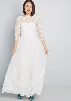Chi Chi London Sophisticated Ceremony Maxi Dress in White - For an occasion unlike any other, this white gown by Chi Chi London is sure to dazzle. Elegant embroidery both bedecks the bodice of this dress and swirls up the hemline of its voluminous tulle skirt. With an illusion, sweetheart silhouette below its bateau neckline, this crop-sleeved stunner is sure to leave you aglow.