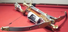 Van-Helsings Automatic Crossbow. Features: 30rd rotary drum-mag; compressed Co2 gas-operation; w/buttstock gas-cylinder.