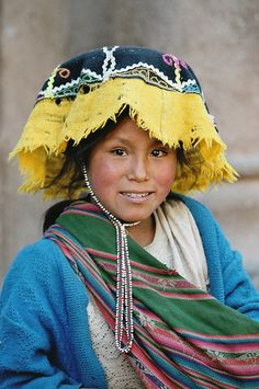A young woman in Peru. Repinned by Elizabeth VanBuskirk. (Probably she is from  Chahuaytire, above Piscac where women weave beautiful beaded jakimas (narrow woven bands) for their hats). See another girl from Chahuaytire below.