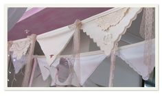 Bunting made from handkerchiefs and doilies.