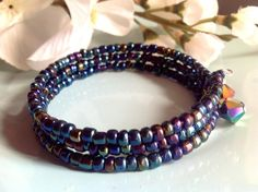 Check out this item in my Etsy shop https://www.etsy.com/listing/209294495/memory-wire-bracelet-seed-bead-bracelet