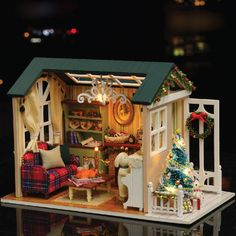 http://www.ebay.com/itm/Holiday-Time-DIY-DollHouse-Miniature-House-Xmas-Gift-LED-Furniture-Kit-Light-Box-/222317540162?ssPageName=STRK:MESE:IT