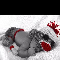 Sock monkey hat and diaper cover with tail that I crochet. My baby is 2 months and I finally took pics putting them on him.