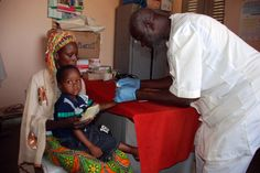 An under 5 infant having his blood taken to detect malaria.