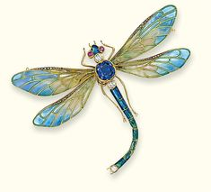 AN EARLY 20TH CENTURY ENAMEL AND GEM-SET BROOCH -  Modelled as a dragonfly, the plique-à-jour enamel wings with rose-cut diamond line detail to the sapphire collet body, diamond and ruby head and blue and green enamel abdomen, mounted in gold, detachable brooch and hairpin fitting, circa 1900
