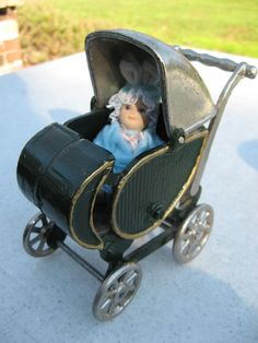 Vintage Cast Iron doll buggy Hibiscus on Ruby Lane  50% off list Price the day of the sale 4/27