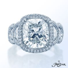 Style 2129 Platinum diamond ring featuring an amazing 6.66 ct cushion diamond in a micro pave halo setting, enhanced with half moon diamonds on the shank.