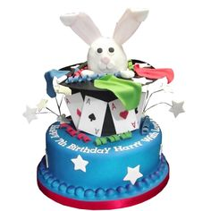 """<b>Magician Cake</b><br />A fun two-tier cake, with the top tier as a Top Hat, with a rabbit made from Krispie Treat coming out of the Top Hat! Gives approx 36 1""""x2"""" portions, from £85"""