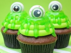 Top cupcakes with green piping gel + candy eyeballs for a spooky snack.