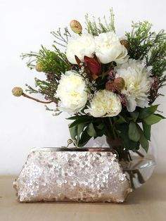 Btw in shop is this bridal/bridesmaids clutch peppered in Blush Champagne Sequins. This can be personalized with a photo you send us so it's make a great photo clutch as gift to the moms too!