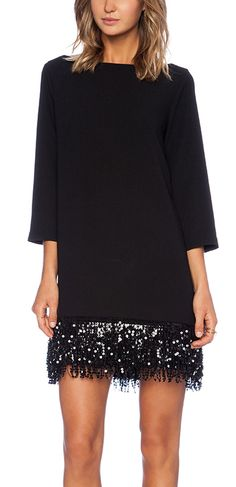 Long-sleeved mini with a sequin fringe hem.