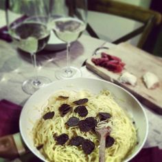 #tagliolini #pasta with #castelmagno #cheese and black #truffle and a tasty #glass of #sparkling_wine . But before let's enjoy some #goat_cheese and a slice of #herbs #pork . All products bought at @latanadelgusto in #cannobio #italy during a wonderful sunny #saturday for a #delicious #romantic #dinner at #home . Of course,we are #food lovers.Enjoy!