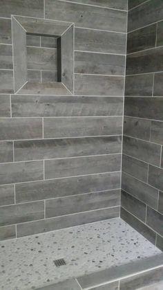 30 Wood Tile Bathroom Design Ideas - Better Homes and Gardens Grey Wood Tile, Wood Plank Tile, Gray Tiles, Wall Wood, Wood Tile Shower, Wood Look Tile Bathroom, Pebble Shower Floor, Bathroom Colors, Gray Tile Bathrooms