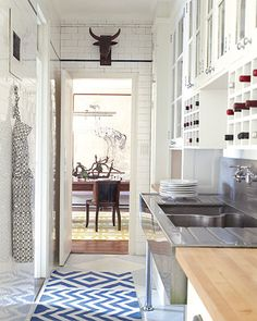 Classic Meets Colorful  Recognizing good design when she sees it, Chused left the apartment's kitchen, with its butcherblock countertops, ample wooden cabinets, and white subway tiles, pretty much as it was. She added the flatweave rug by Madeline Weinrib and the bull's-head sculpture, a flea market find.