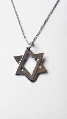 Enjoy this stylish yet modern Star of David pendant with 14K #White #Gold. This #pendant has great symbolism and makes the perfect #gift for the Jewish holidays or for a birthday ! Details: Dimensions: 1.5 cm (length) x 1.15 cm (width) 14K White Gold Total Weight: 0.60 grams $80