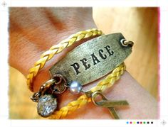 """Lenny and Eva Peace Bracelet on Yellow Braided Leather band. Love this style but with """"Family"""" or """" Free Spirit"""""""