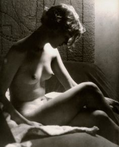Man Ray, Lee Miller by the light of a Sunray Lamp, Paris, 1929.