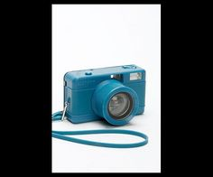 This camera sports a fisheye lens, turning each photo into a distorted circular image. Fisheye Lens, Teal, Turquoise, Fujifilm Instax Mini, Turning, Cameras, Blue Green, Colorful, Technology
