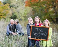 I love the idea of the parents getting cozy in the background with the kids sort of goofing around in the foreground (instead of the sign, for our family, anyway). Family Picture Poses, Family Photo Sessions, Family Posing, Family Pictures, Family Portraits, Cute Family, Fall Family, Family Kids, Creative Photos