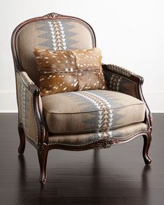 """Handcrafted bergere chair. Hardwood frame. Acrylic/polyester upholstery. Hairhide kidney pillow. 35""""W x 36""""D x 41""""T. Seat, 26""""W x 19""""D x 20""""T; arms, 26""""T. Made in the USA of imported materials. Boxed"""