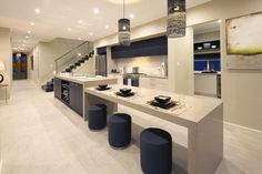 love this use of ceasarstone and incorporating the dining table into the kitchen bench