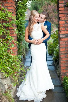Bride & Groom Portrait in a country garden - Natasha Cadman Photography - Bride in Lace Pronovias Gown & Jimmy Choo Shoes for an elegant classic wedding in York with lilac Coast bridesmaids dresses, gypsophila posies, Navy Groomsmen suits & fish & chip supper.