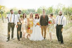 Katrina & Joshua fall florals in a vineyard wedding via Offbeat Bride. Photo by JRP93. -- I like the mismatched, floral bridesmaids' dresses