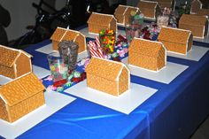 Pre-made all the gingerbread houses out of graham crackers and then provided every kind of candy imaginable and zip top baggies of royal icing for the kids to work with. (She averaged 5 houses for 1 box of graham crackers.)