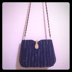 Blue Weaved Shoulder Bag/Crossbody Bag Pretty dark blue crossbody/shoulder bag.  Hard outer shell.  Single strap.  Interior has a plastic lining with a zippered pocket.  Gold colored hardware.  Couple small stains on lining.  This is a great, retro style bag perfect for spring and summer! Bags Crossbody Bags
