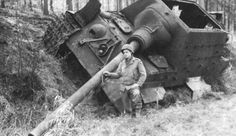 American soldier (101st Airborne?) with a killed Jagdtiger (Hunting tiger), France, 1944.