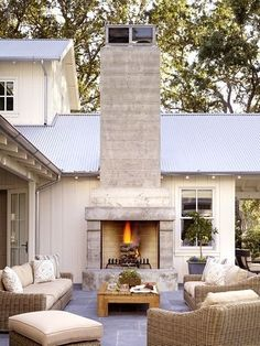 fireplace outdoors on the patio / wicker furniture