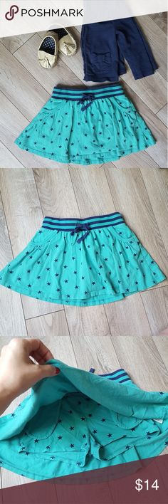 Mini Boden skort Mini Boden green skirt with blue stars.  Elastic waist with drawstring makes the perfect fit.  There is one very small hole as shown in one of my pictures.   100% cotton Size 5-6y Mini Boden Bottoms Skorts