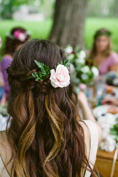 fishtail half up look with beachy waves and a flower by Gina Kay