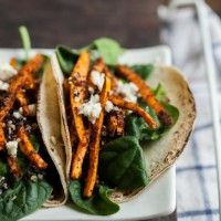 """Crispy Quinoa and Mole Sweet Potato Tacos from Naturally Ella. Top with cashew """"goat"""" cheese!"""
