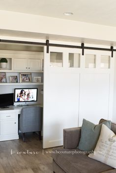 Sliding Barn Door and Desk Nook. Built in White Desk and Privacy Barn Door. White and Chrome House. {B Couture Photography}