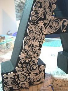 Quilling done on wooden letters - love the detail shown in this photo & great gift idea...