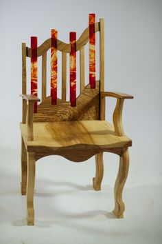 The School's encouragement of students to let their creative juices flow has resulted in this stunning chair featuring Sycamore wood and stained glass pieces.